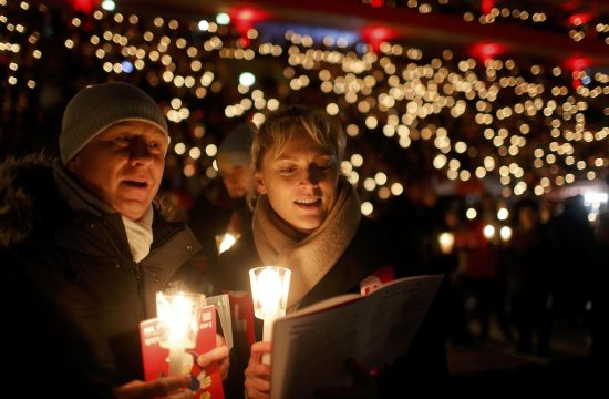 """People attend the """"Weihnachtssingen"""", a candle-lit carol concert with 28500 fans of the second-division club FC Union Berlin at the Alte Foersterei stadium in Berlin, Germany, December 23, 2016. REUTERS/Hannibal Hanschke"""