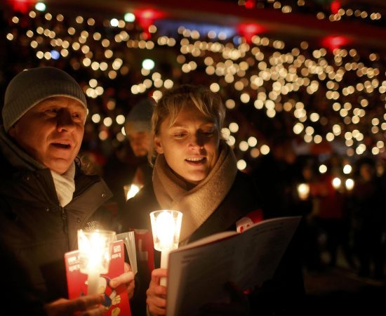 "People attend the ""Weihnachtssingen"", a candle-lit carol concert with 28500 fans of the second-division club FC Union Berlin at the Alte Foersterei stadium in Berlin, Germany, December 23, 2016. REUTERS/Hannibal Hanschke"