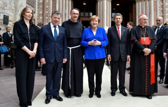 "(L/R): Clemencia de Santos poses alongside her husband Colombian President and Nobel Peace Prize winner Juan Manuel Santos, Mauro Gambetti Guardian of Sacro Convento, Germany's Chancellor Angela Merkel, Merkel's husband Joachim Sauer and Cardinal Agostino Vallini ahead of Merkel receiving the lamp of St. Francis  - the ""Nobel"" Catholic for ""her work of conciliation for the peaceful cohabitation of peoples""  - at The Basilica Superiore of St Francis of Assisi, in Assisi on May 12, 2018. (Photo by Andreas SOLARO / AFP)        (Photo credit should read ANDREAS SOLARO/AFP/Getty Images)"